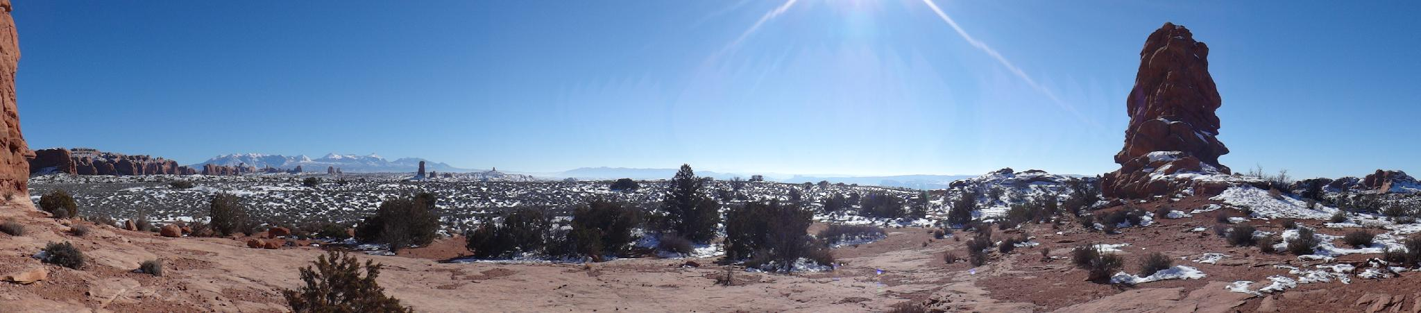 Winter panorama from behind Balanced Rock. The La Sal Mountains and Windows in the background.